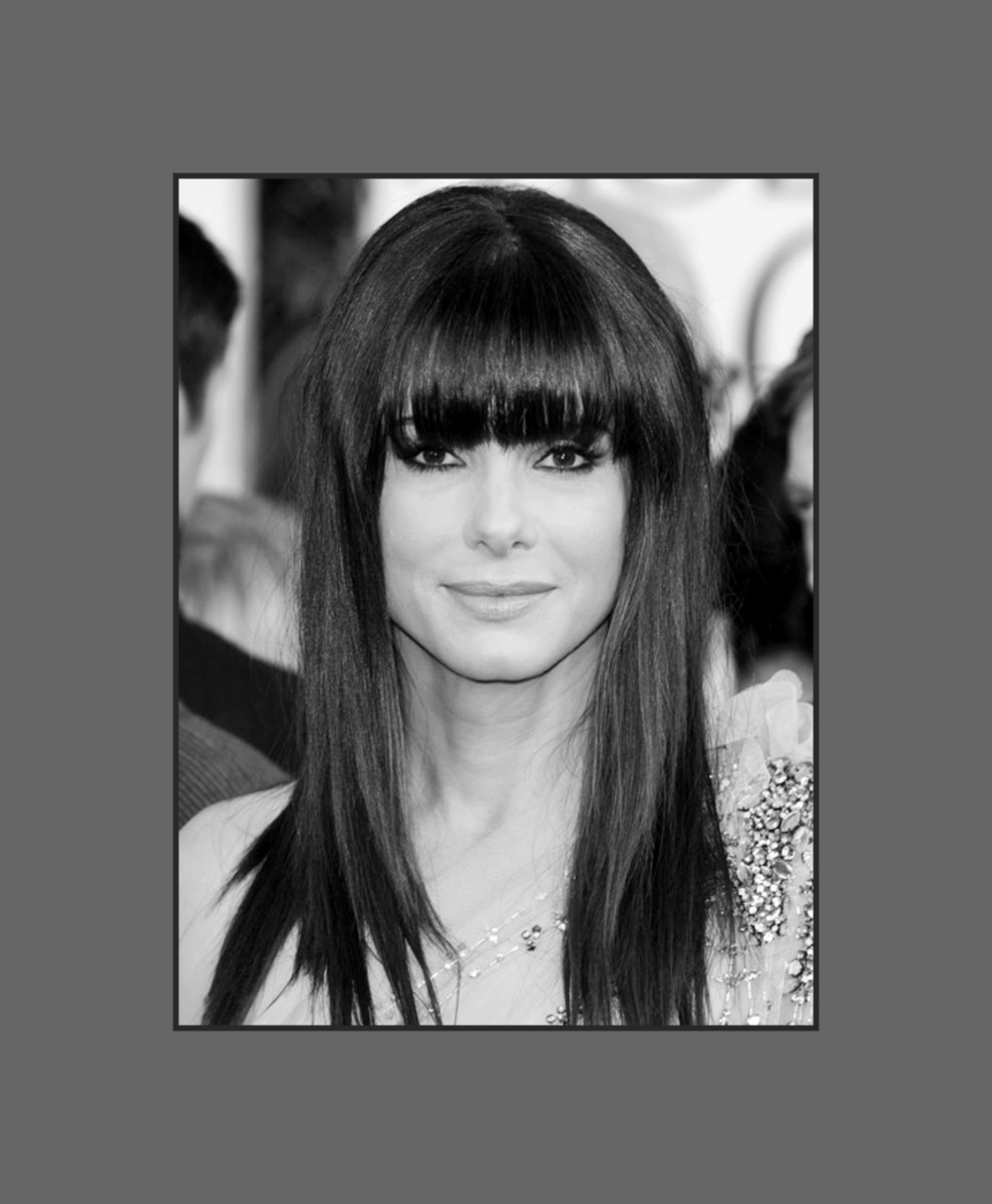 Sandra Bullock looks gorgeous with straight long full bangs. Big full bangs look great for square faces - 2013 Hairstyles with Bangs for Round, Oval, Square, Heart, Oblong Face