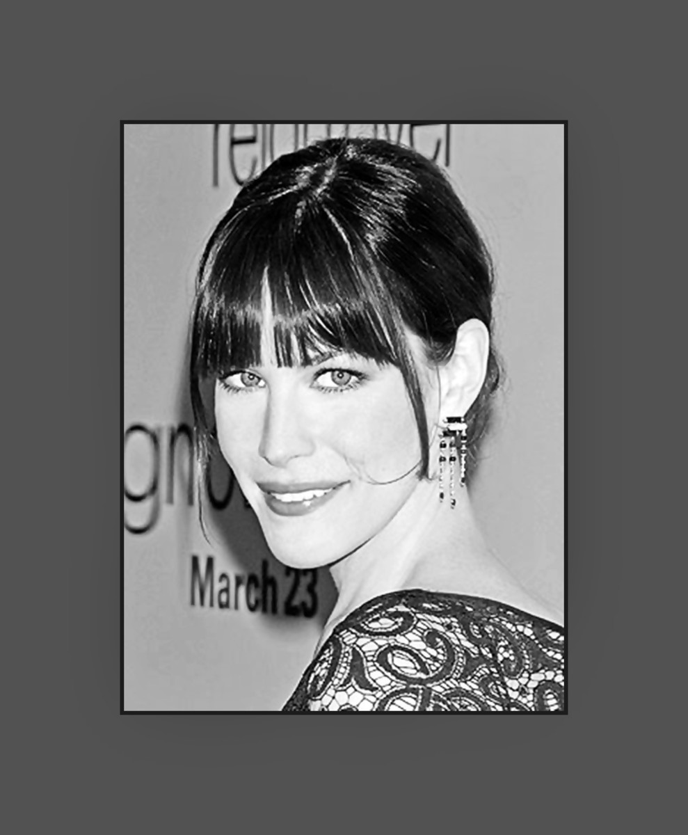 Liv Tyler's hairstyle with long choppy bangs is very flattering on her oblong face.  The long strand on the side makes her updo very chic and trendy - 2013 Hairstyles with Bangs for Round, Oval, Square, Heart, Oblong Face