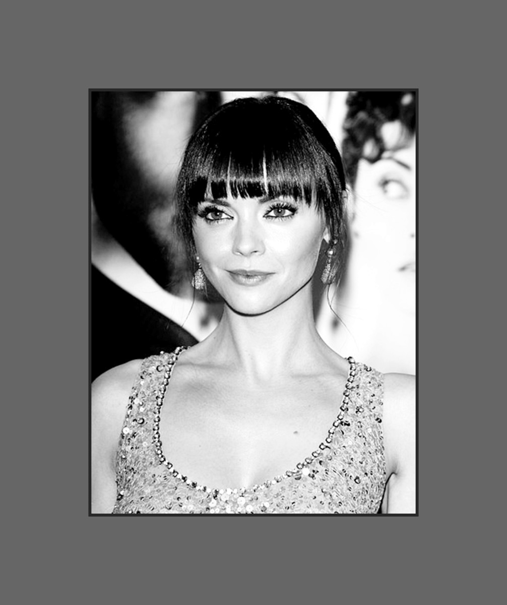 Christina Ricci's hairstyle with long cropped bangs rocks!  Christina knows how to wear bangs that will flatter her heart shape face - 2013 Hairstyles with Bangs for Round, Oval, Square, Heart, Oblong Face