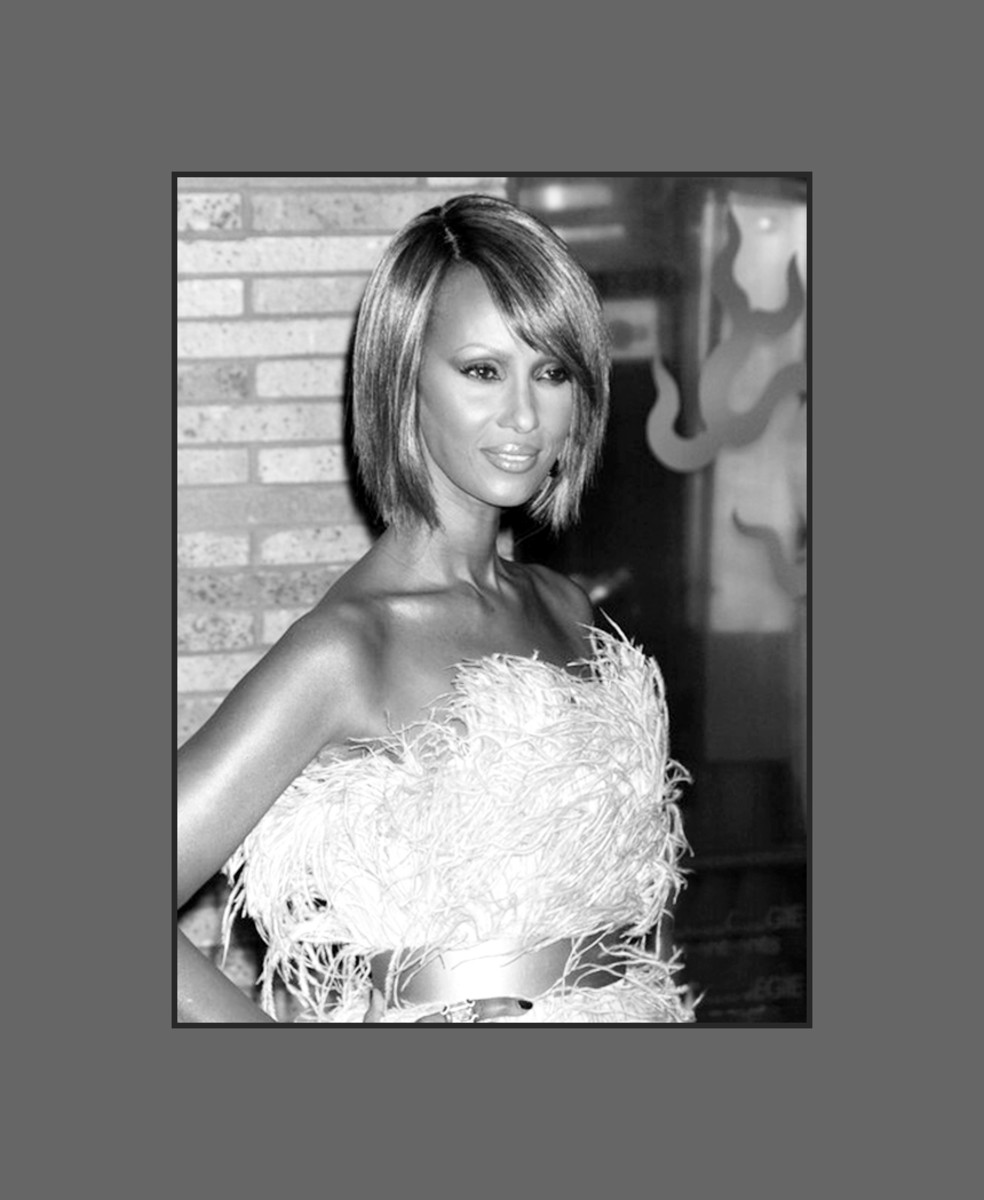 Fashion model Iman (David Bowie's beautiful wife) looks stunning!  Her bob hairstyle with long side-swept bangs is very flattering on her oblong face - 2013 Hairstyles with Bangs for Round, Oval, Square, Heart, Oblong Face