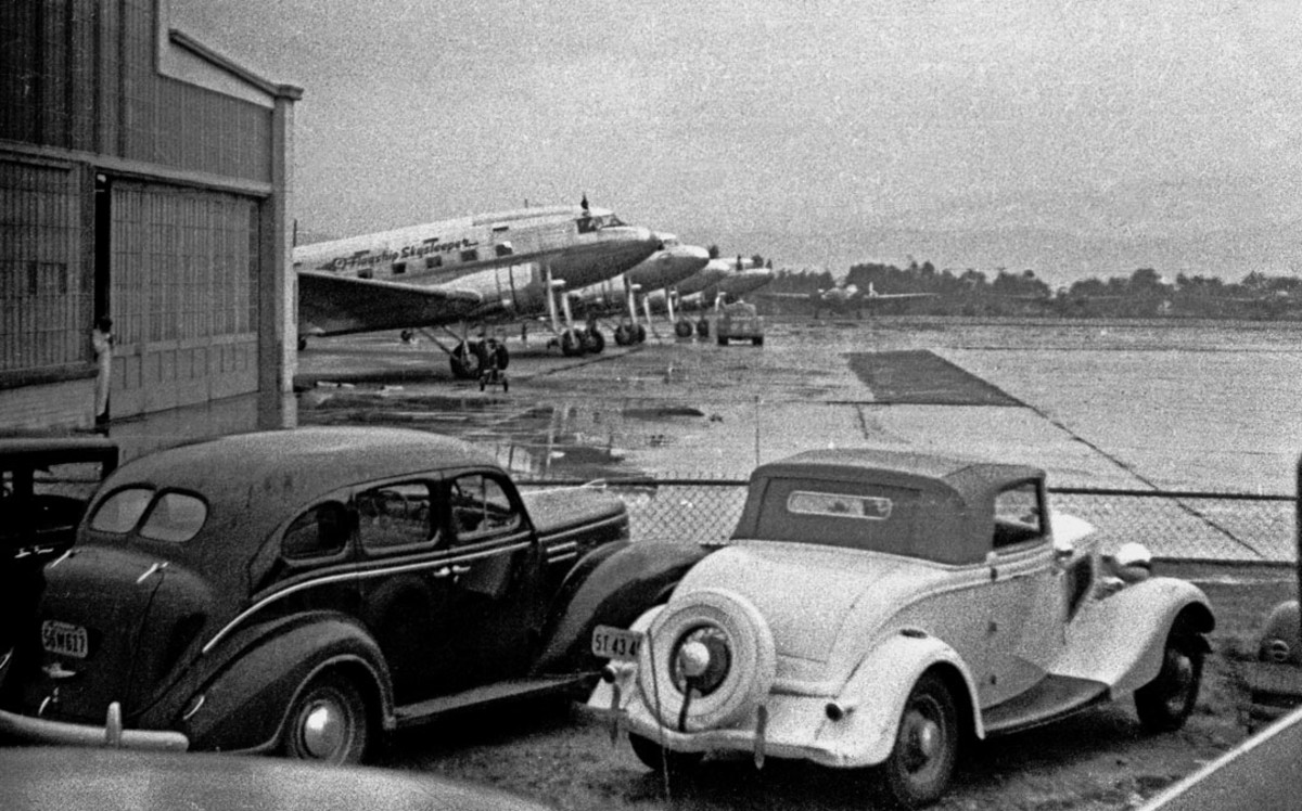 I believe this is Burbank airport on a rainy day in the early 1940s. The DC3 first in the line is an American Airlines Flagship Skysleeper. These aircraft were equipped with individual berths and required approximately 17 hours to fly coast to coast.