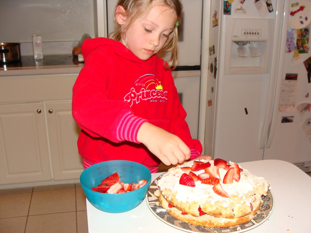 Then she adds the strawberries.