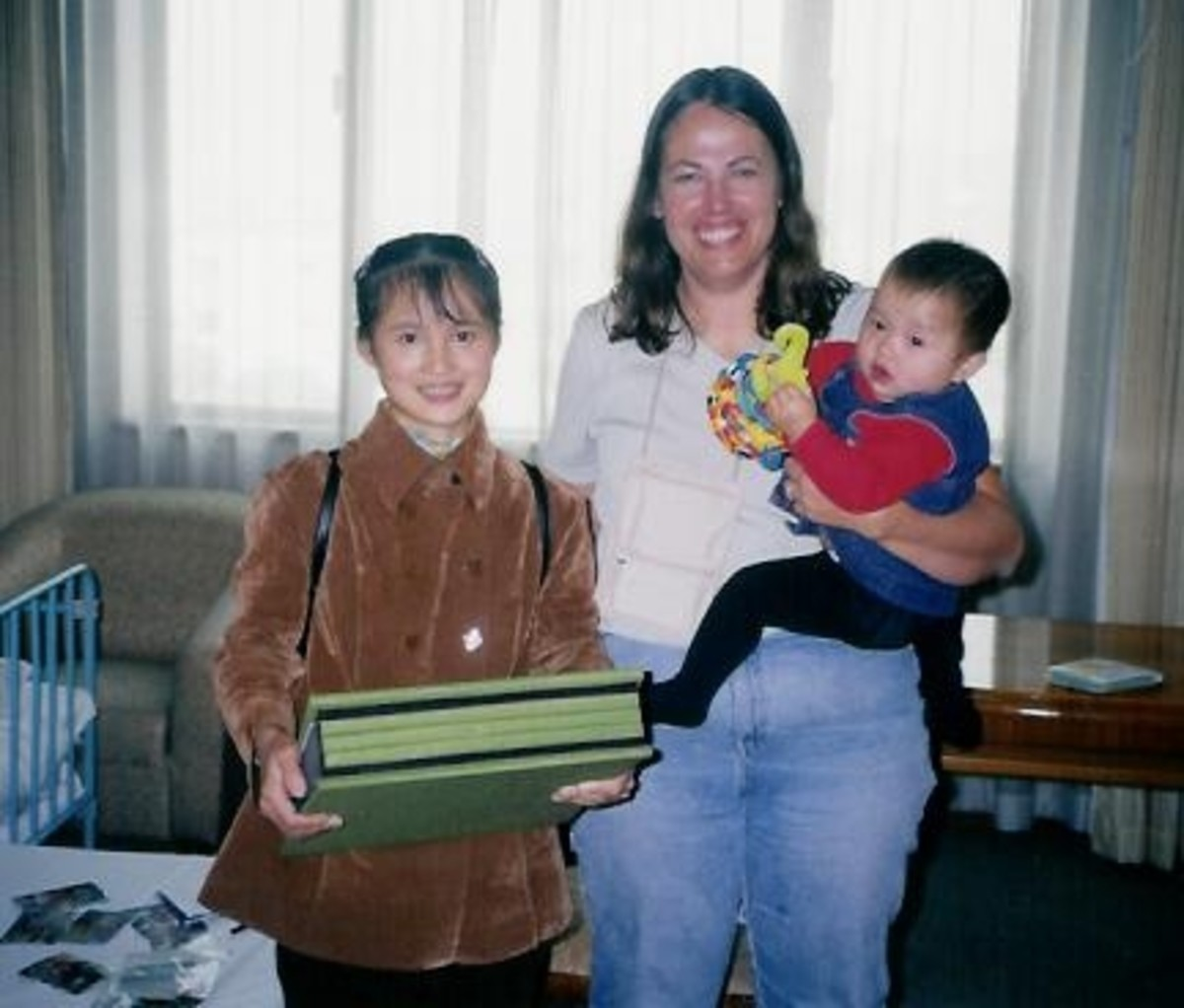 Adoption Day: Mrs. Lee, Mollie and Me right after I'd given her the scrapbook from the other Wuzhou adoptive parents.