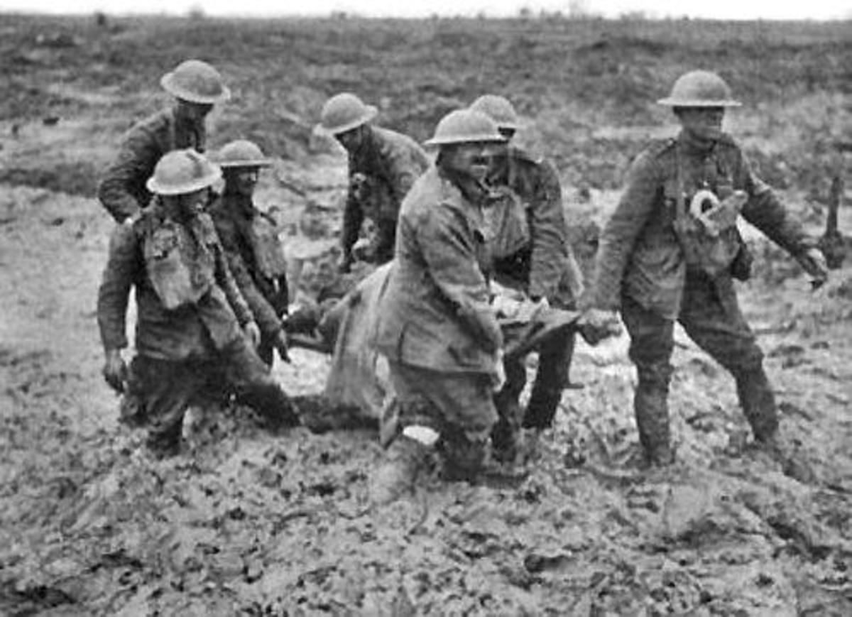 Stretcher bearers in the mud