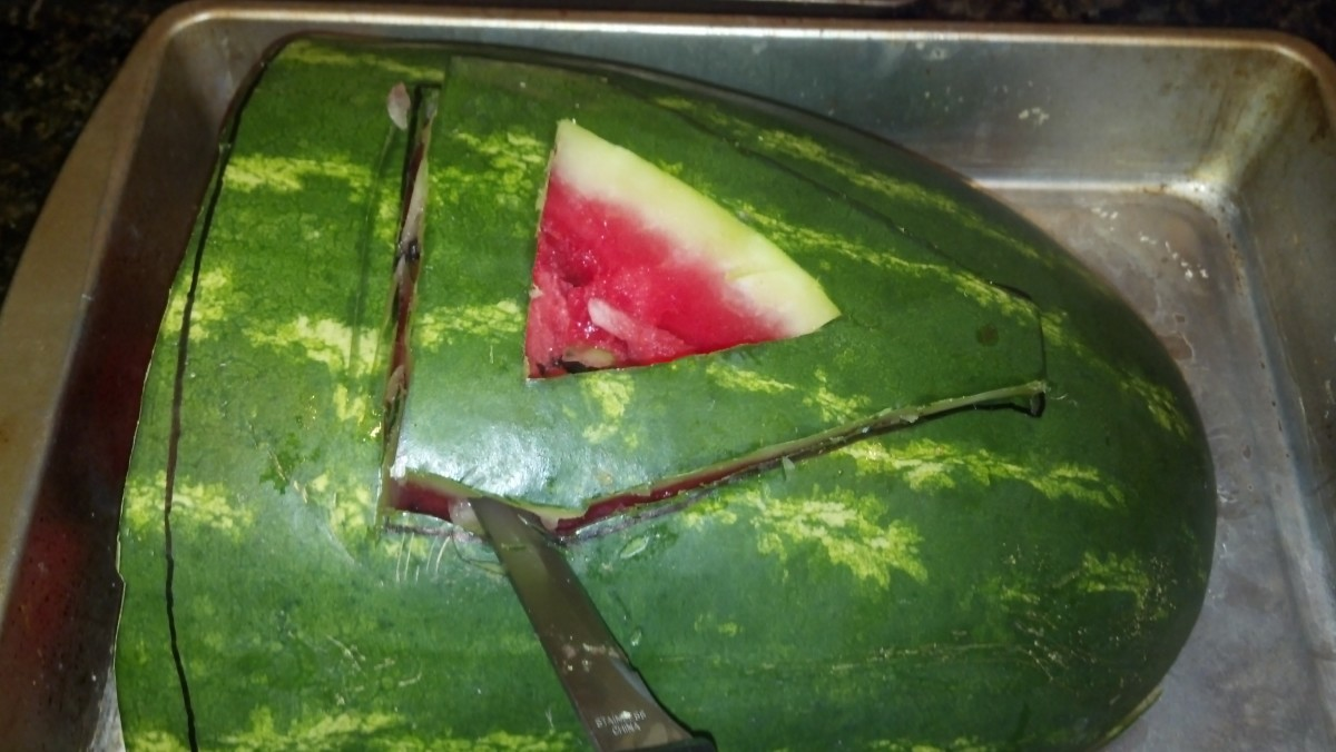 Cut out the inner triangle first. Then cut along the outside of the handle and trim off watermelon.