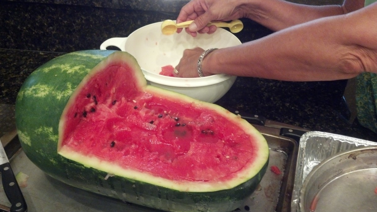 Scoop out the watermelon and place in a separate container.