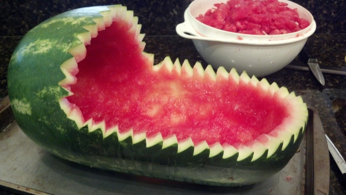 Cut small triangles along the opening of the watermelon to create a decorative edge.