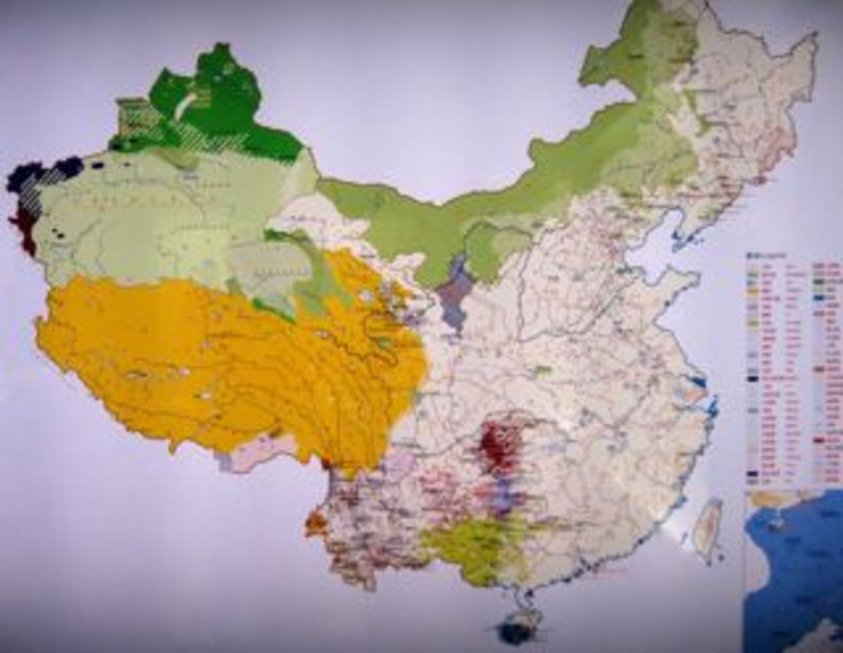 "This map of China indicates the location of  different ethnic groups.  (See legend.)  Note the similarity to a  ""rooster"" in the outline of the country."