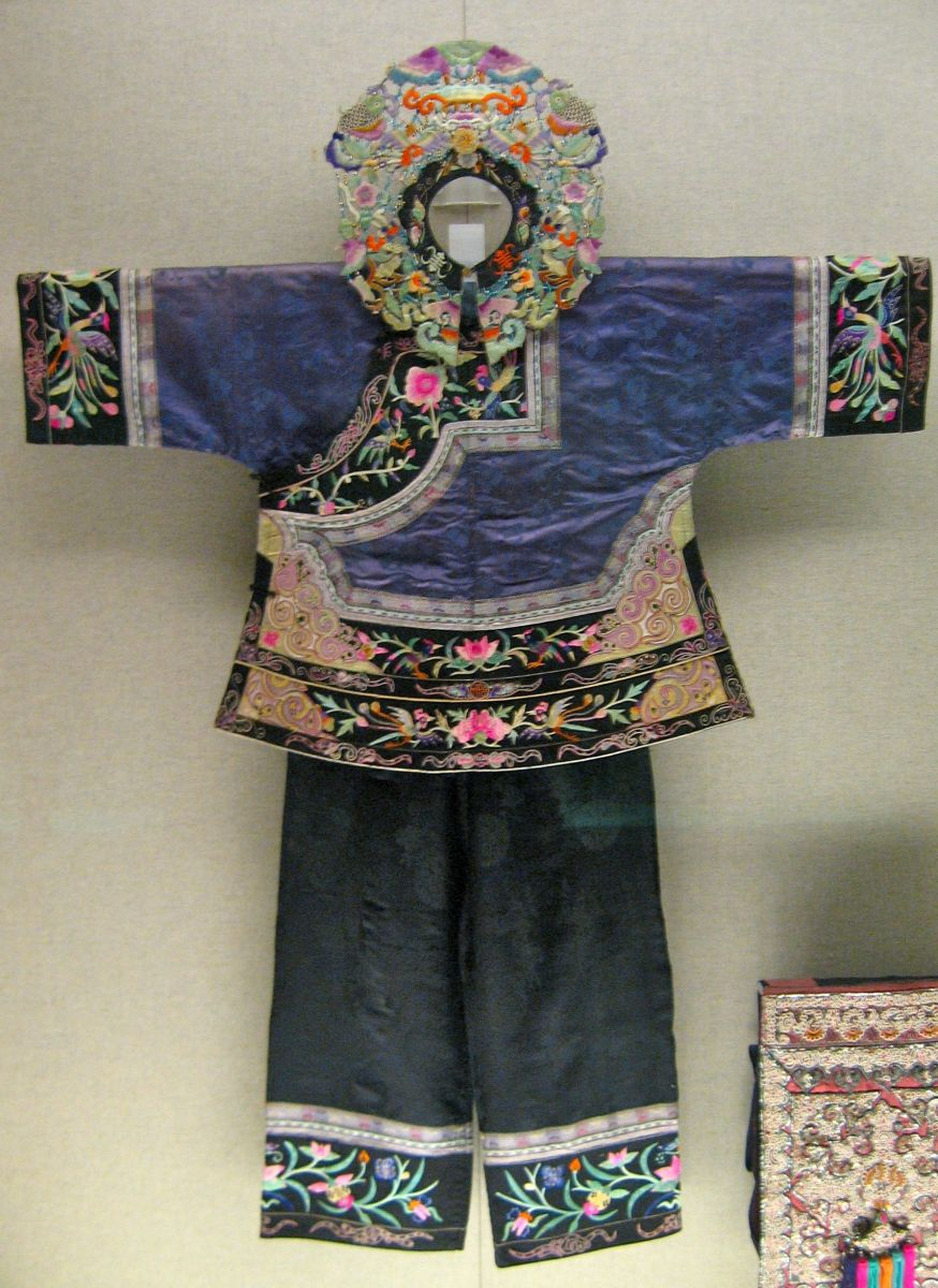 "Woman's outfit embroidered with ""bird-and-flower"" motif.  Tujia ehnic minority.  1st half 20th Century."