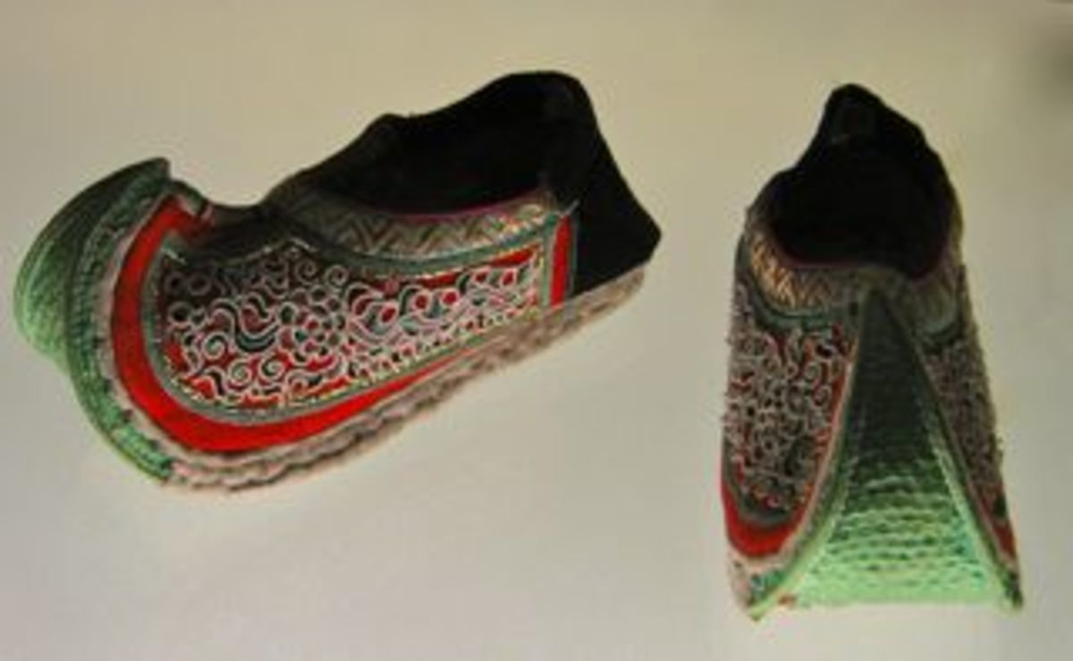 Shoes with upturned toe and couching embroidery.  Dong ethnic minority.  2nd half 20th Century.