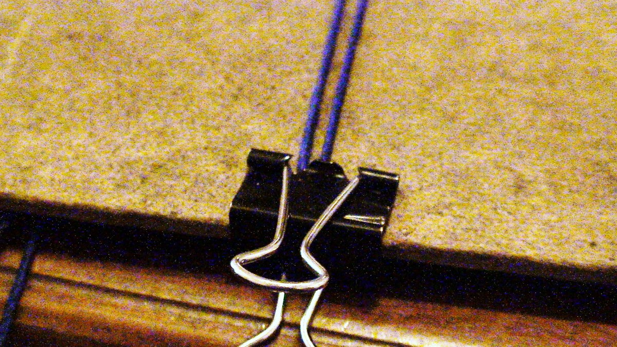 6.  Anchor the two filler chords to a clip board using a stationary clip.