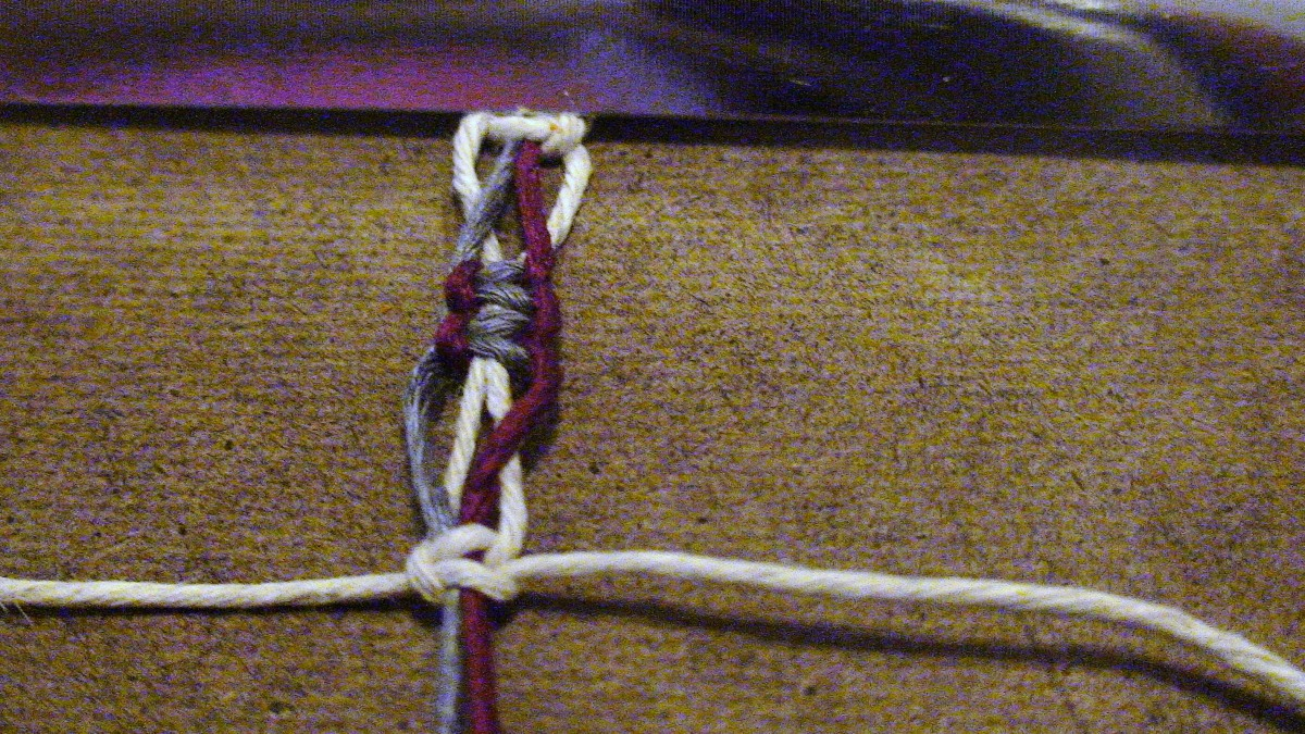 13.  The switch knot held in place by one square knot.