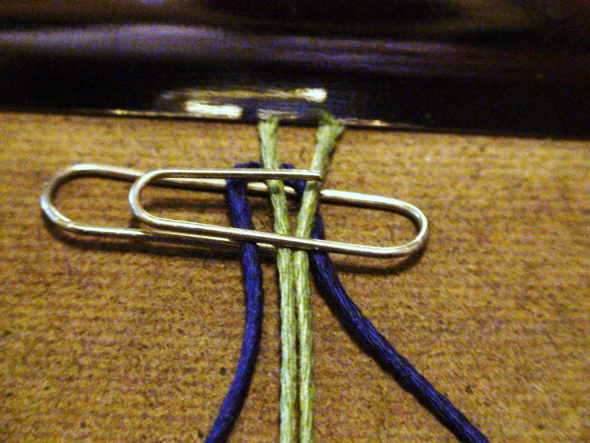 2.  Use a paper clip to keep the blue chord from shifting so it stays centered.
