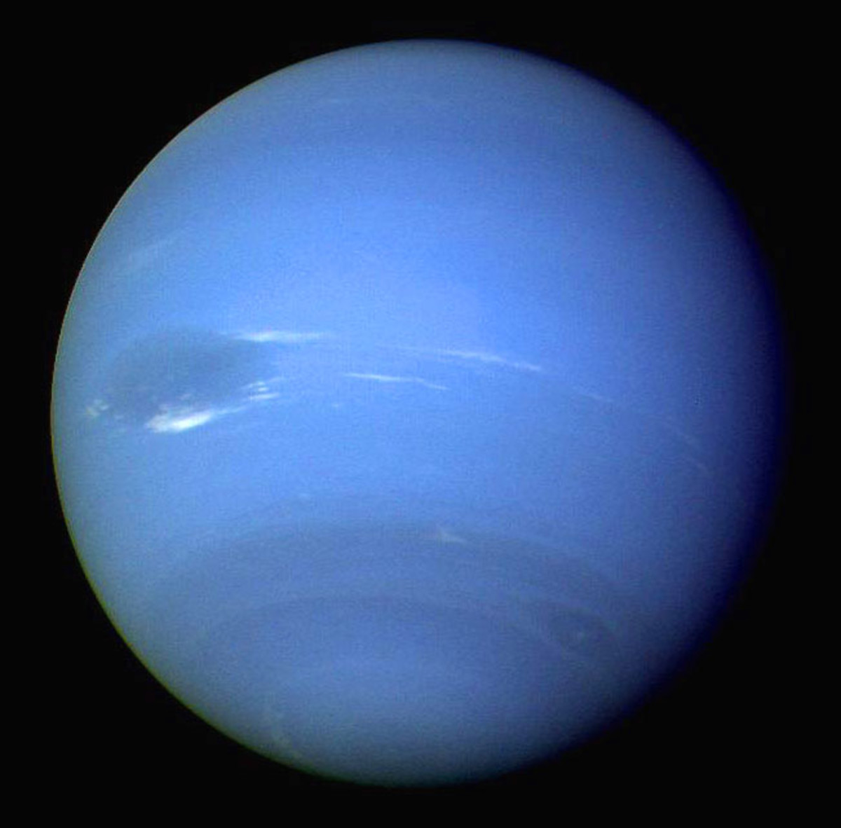 Neptune is the most distant planet from the Sun. Visible is the Great Dark Spot - a massive storm similar to that seen on Jupiter.