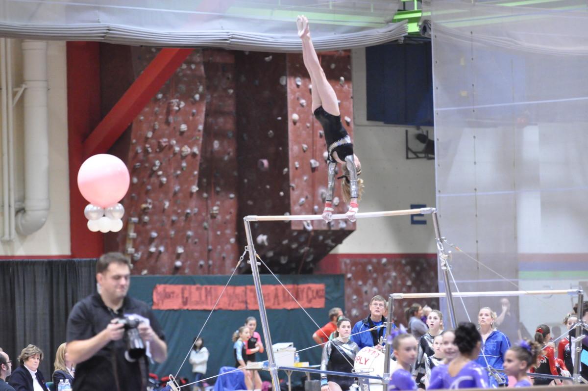 USAG Level 8 Athlete giant swing on bars