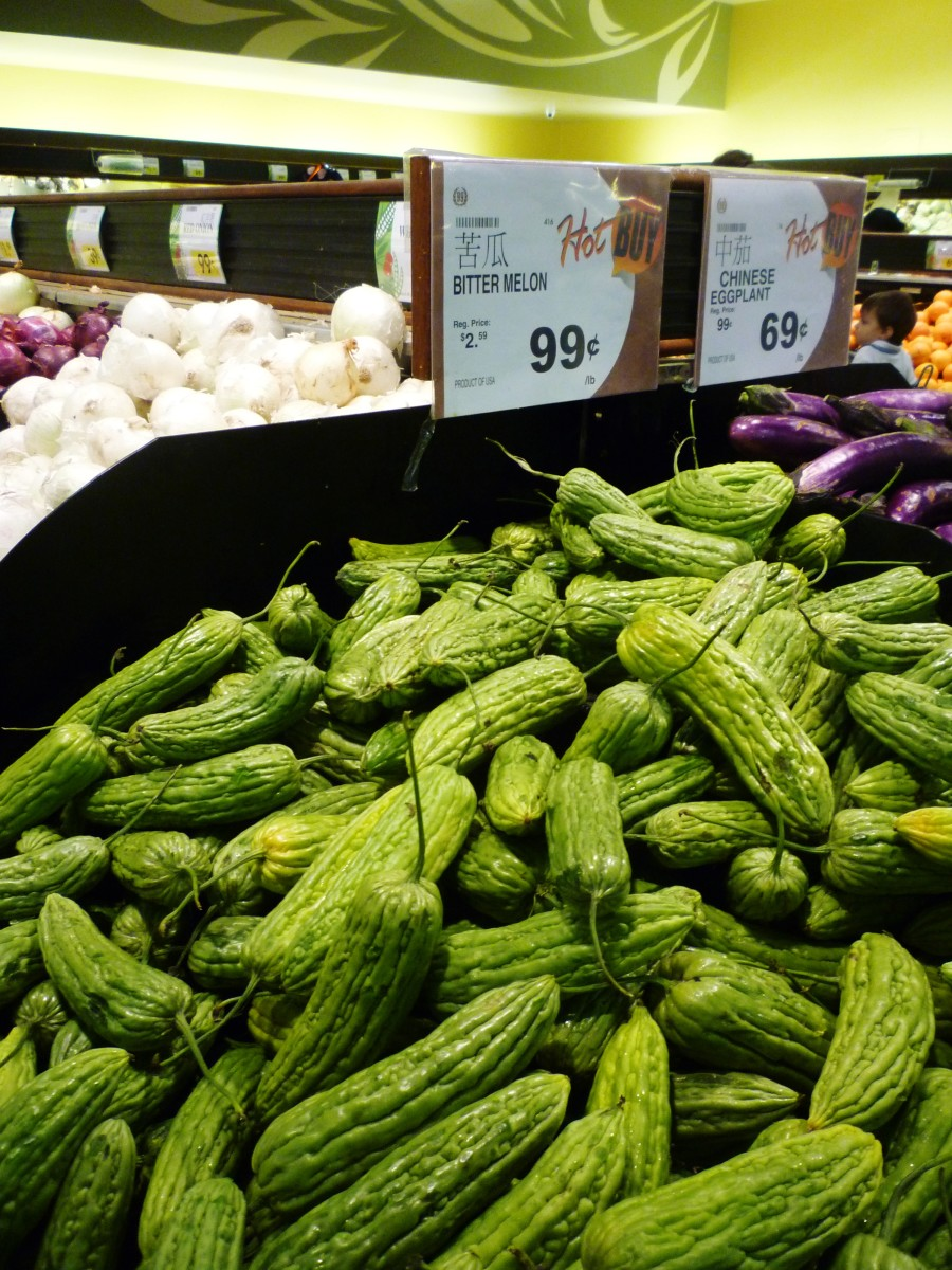 Bitter melons along with other produce in an Asian grocery store, Houston, Texas