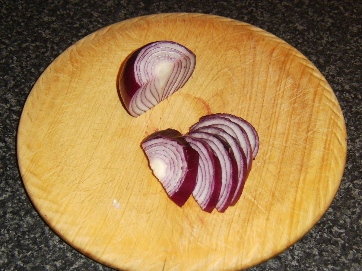 Red onion half is finely sliced for gravy