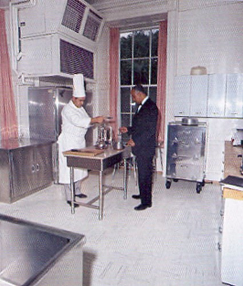Executive Chef Rene Verdon and butler John Ficklin in Jackie Kennedy's First Family kitchen in 1961
