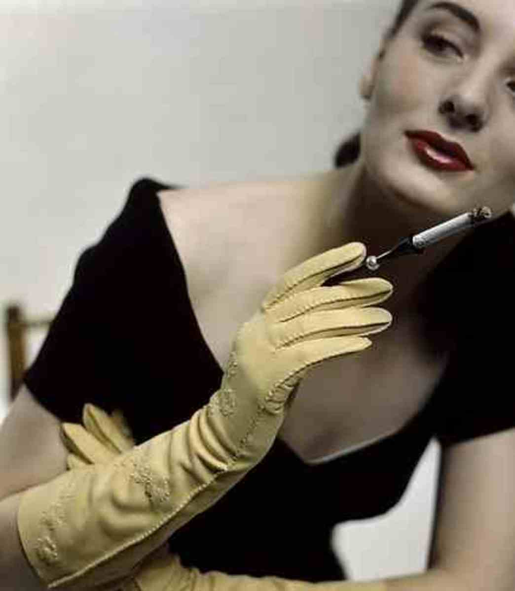 Femme Fatale gloves and cigarette holder favim.com