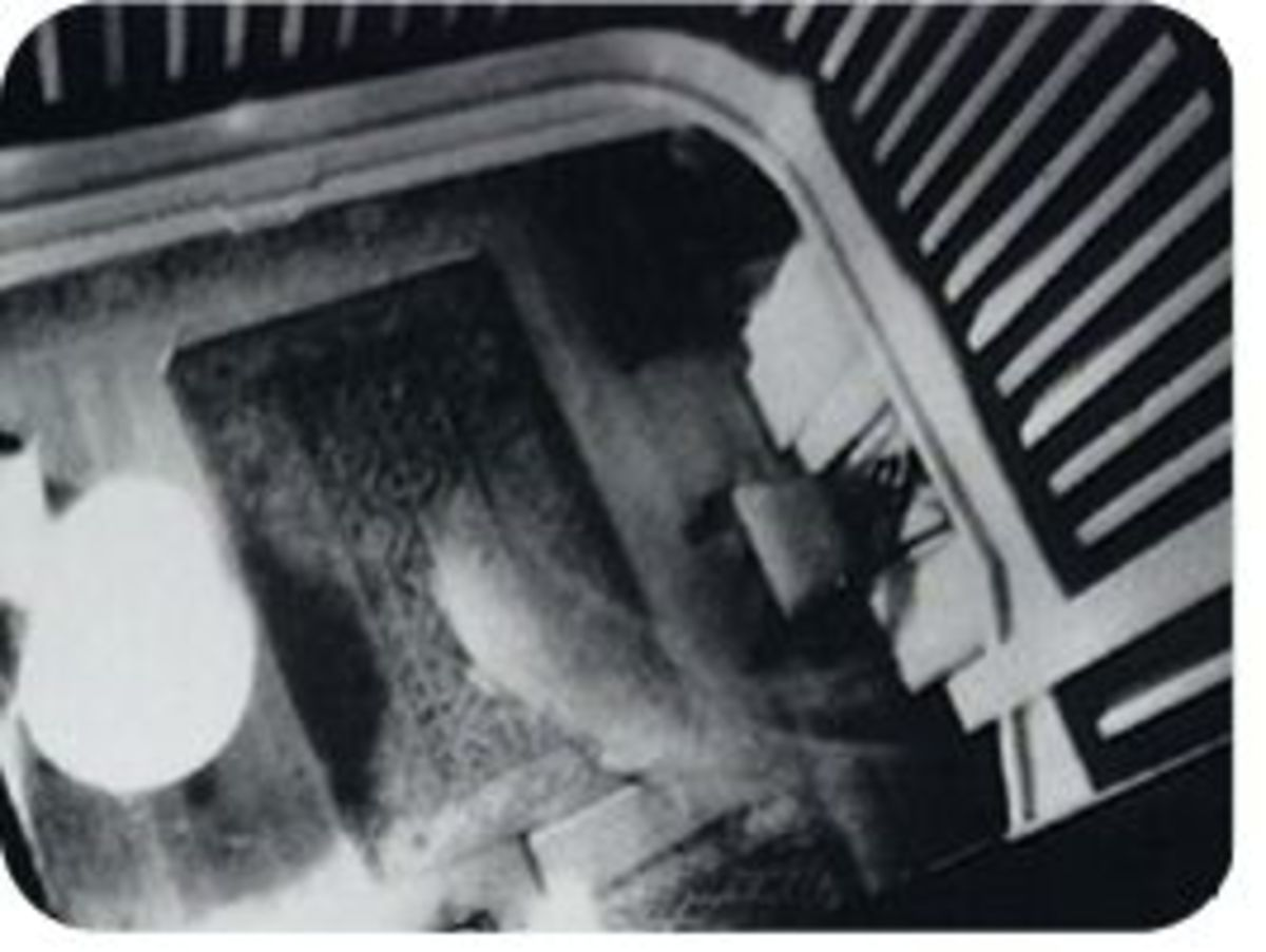 A white mist as seen looking down from the stairway of the Baleroy Mansion- perhaps a ghost?