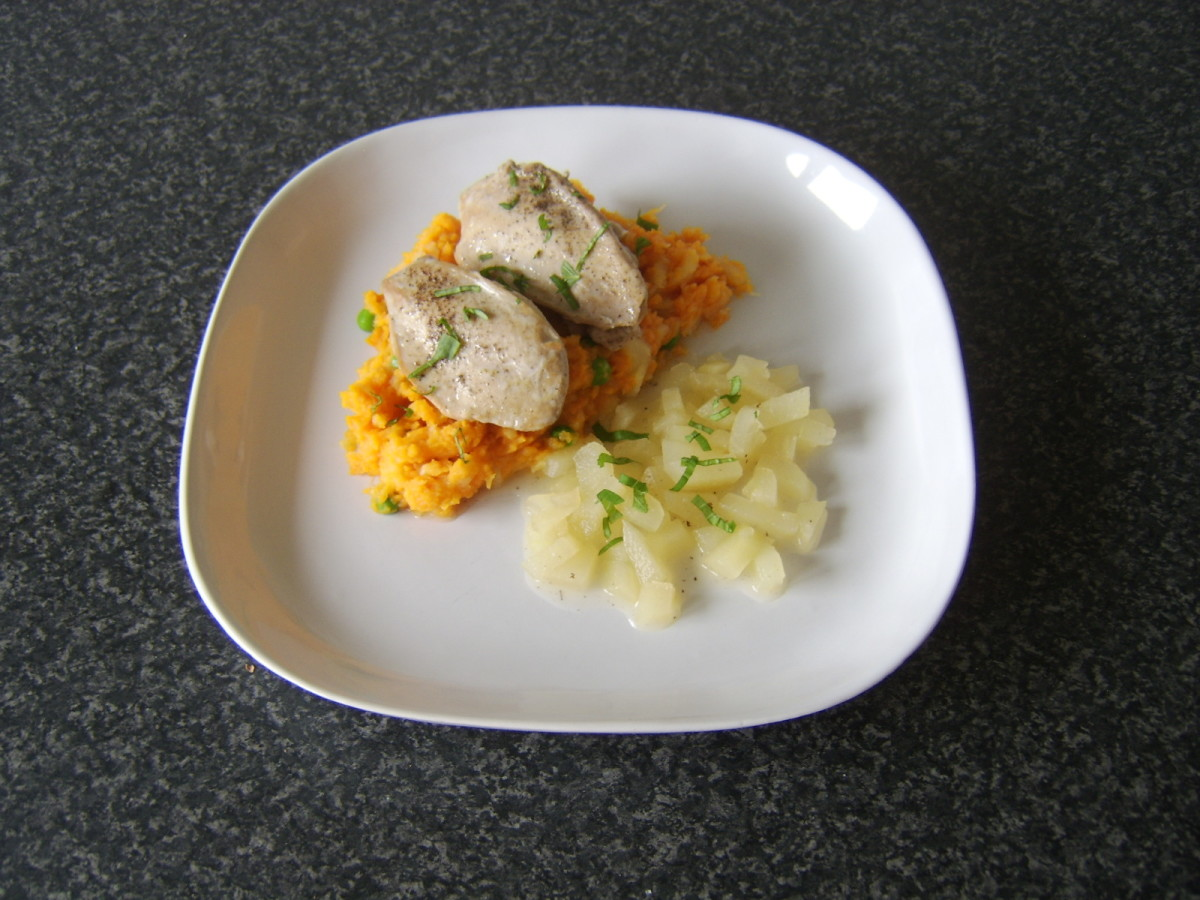 Pan seared partridge breasts on a bed of sweet potato and parsnip mash served with simple pear sauce