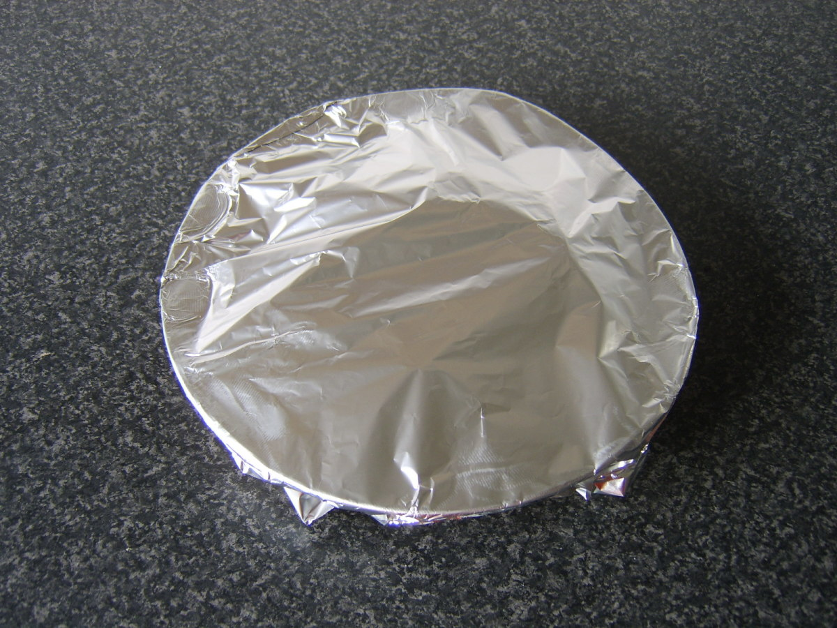 Partridge is covered with tinfoil to rest