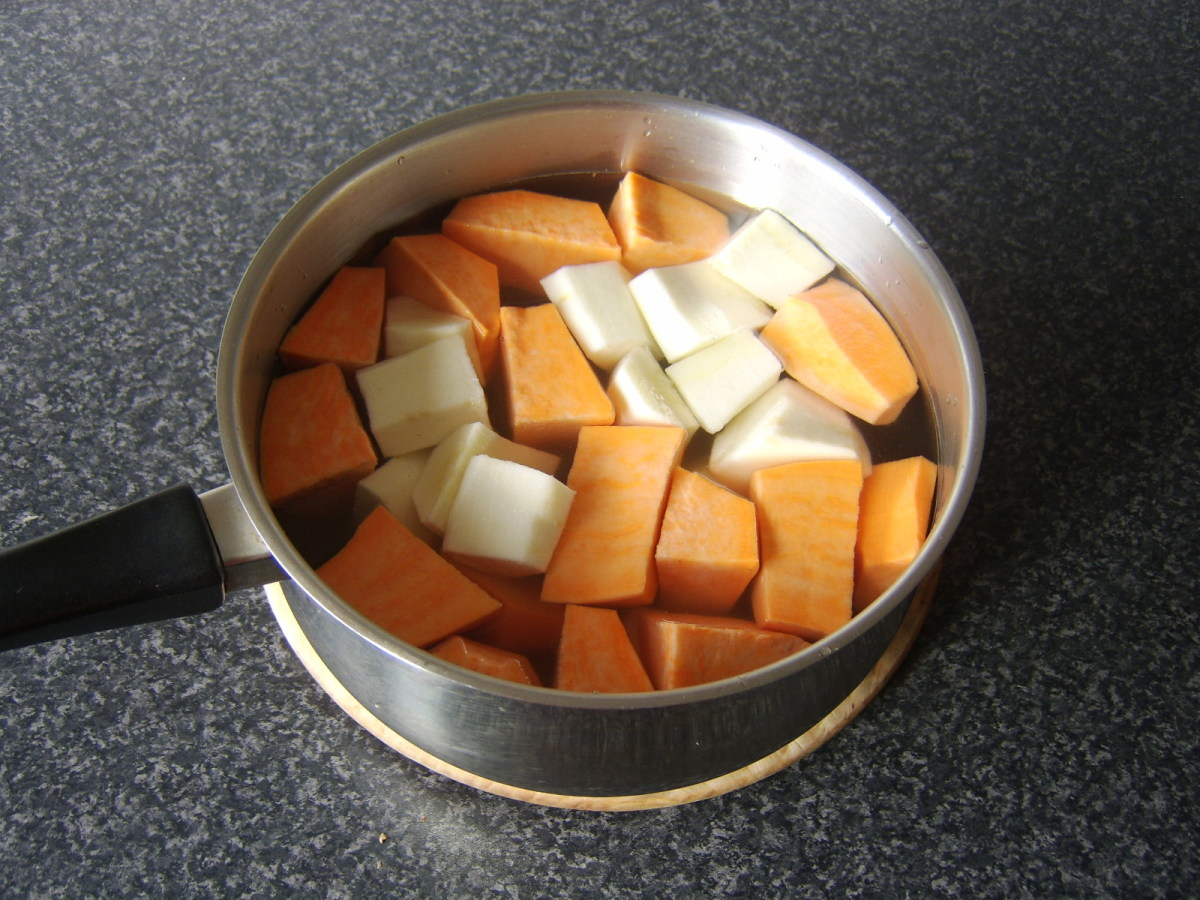 Sweet potatoes and parsnip prepared for boiling