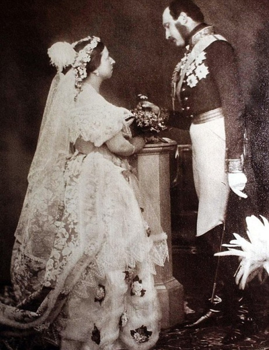 Queen Victoria posing in the 1860s wearing the wedding dress that she wore in 1840
