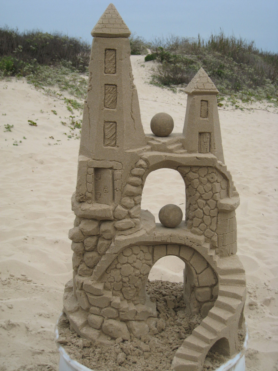 how to build a sandcastle Some useful tips and tricks for building and carving a better sand castle - no artistic experience required sandy feet has taught thousands of people how to have more beach fun and she can.