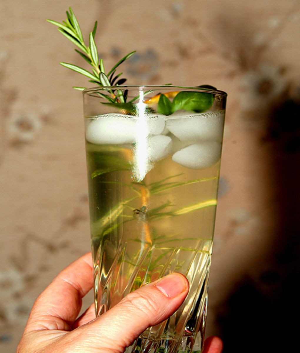 Garnish with a fresh sprig of rosemary and basil and serve.