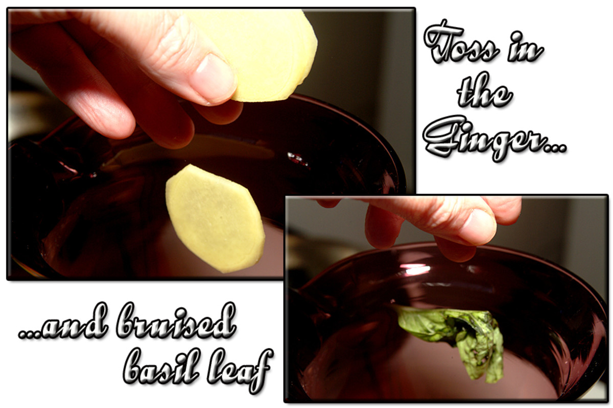 Toss in the ginger slices and the bruised basil leaf along with all of the other ingredients, except the honey.