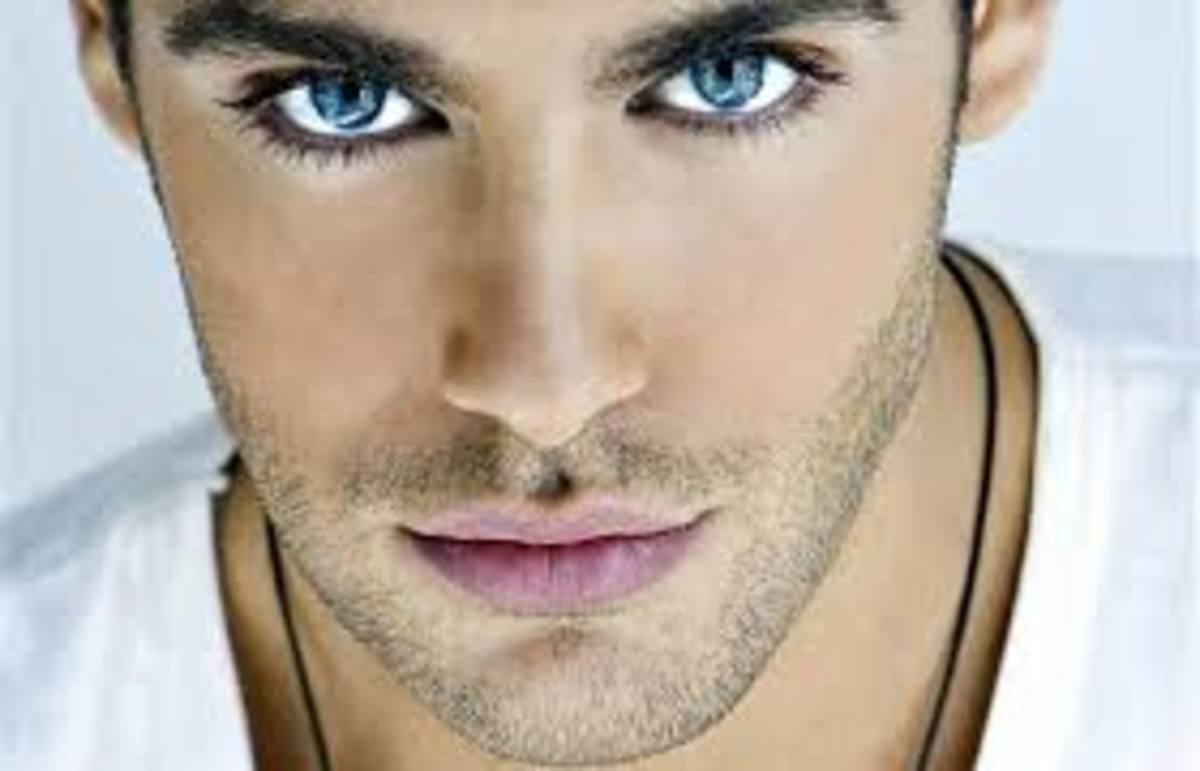What is conveyed in the eyes of this handsome man's picture?