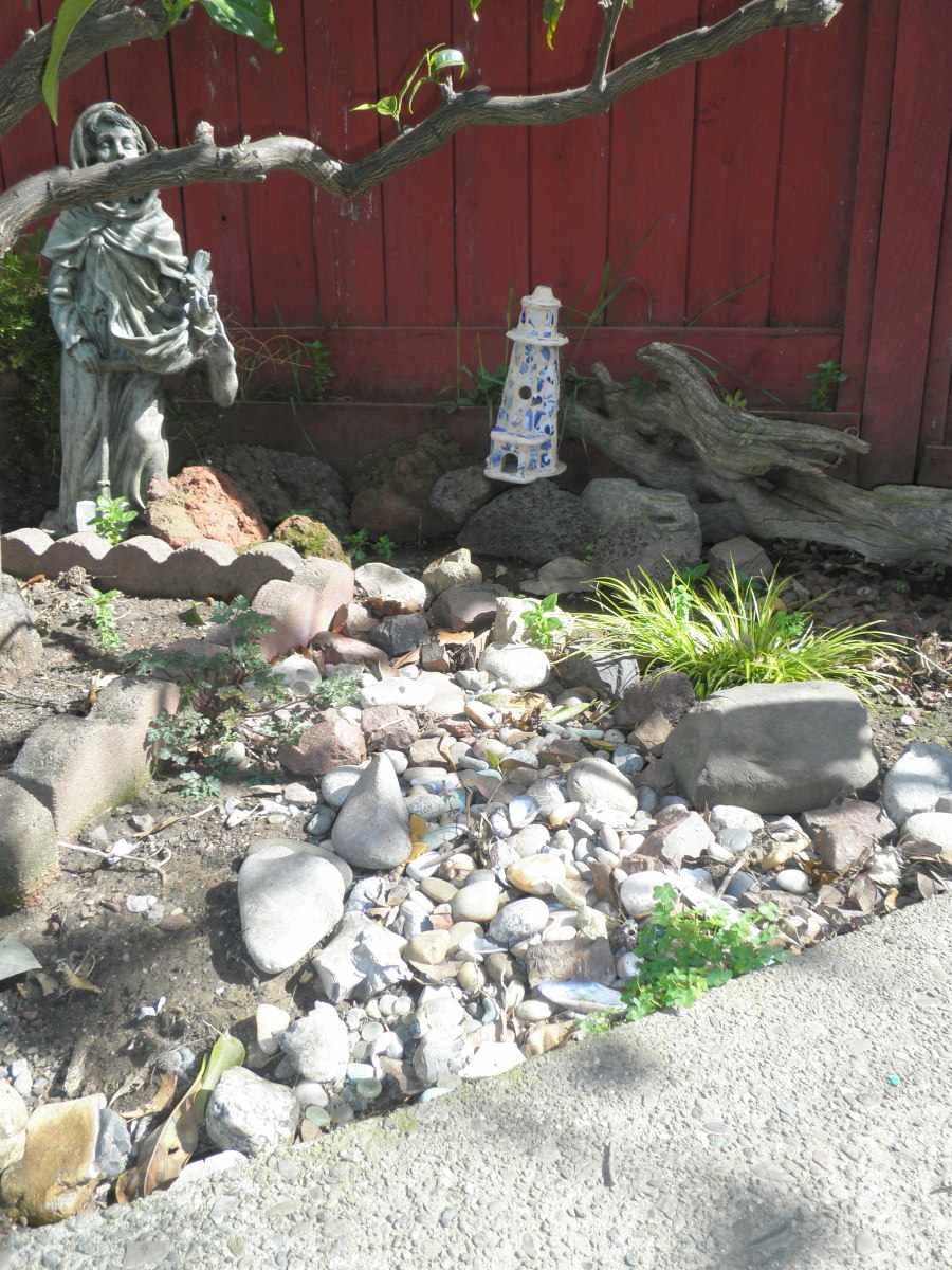 "This ""river"" in my yard was made from stones and rocks I had collected over the years.. I put them all together to make a dry river bed under my orange tree. Sustainable landscaping materials make good use of what you already have."