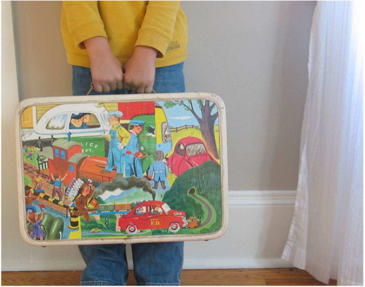 Images from a storybook are used to decoupage this cute kid's suitcase.