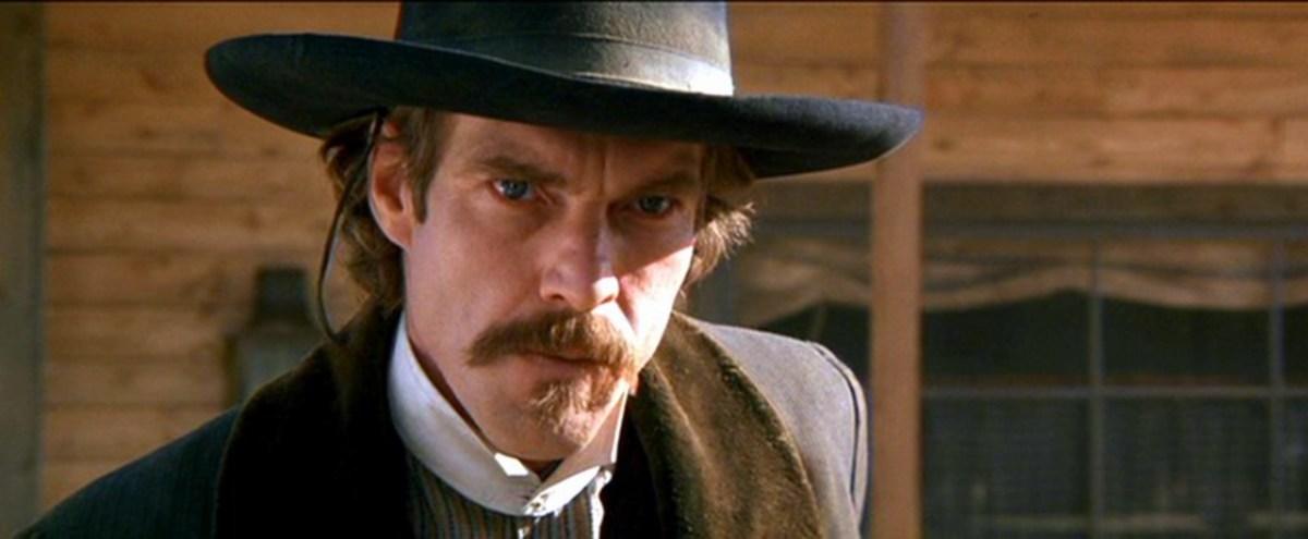Dennis Quaid as Doc Holliday in Wyatt Earp