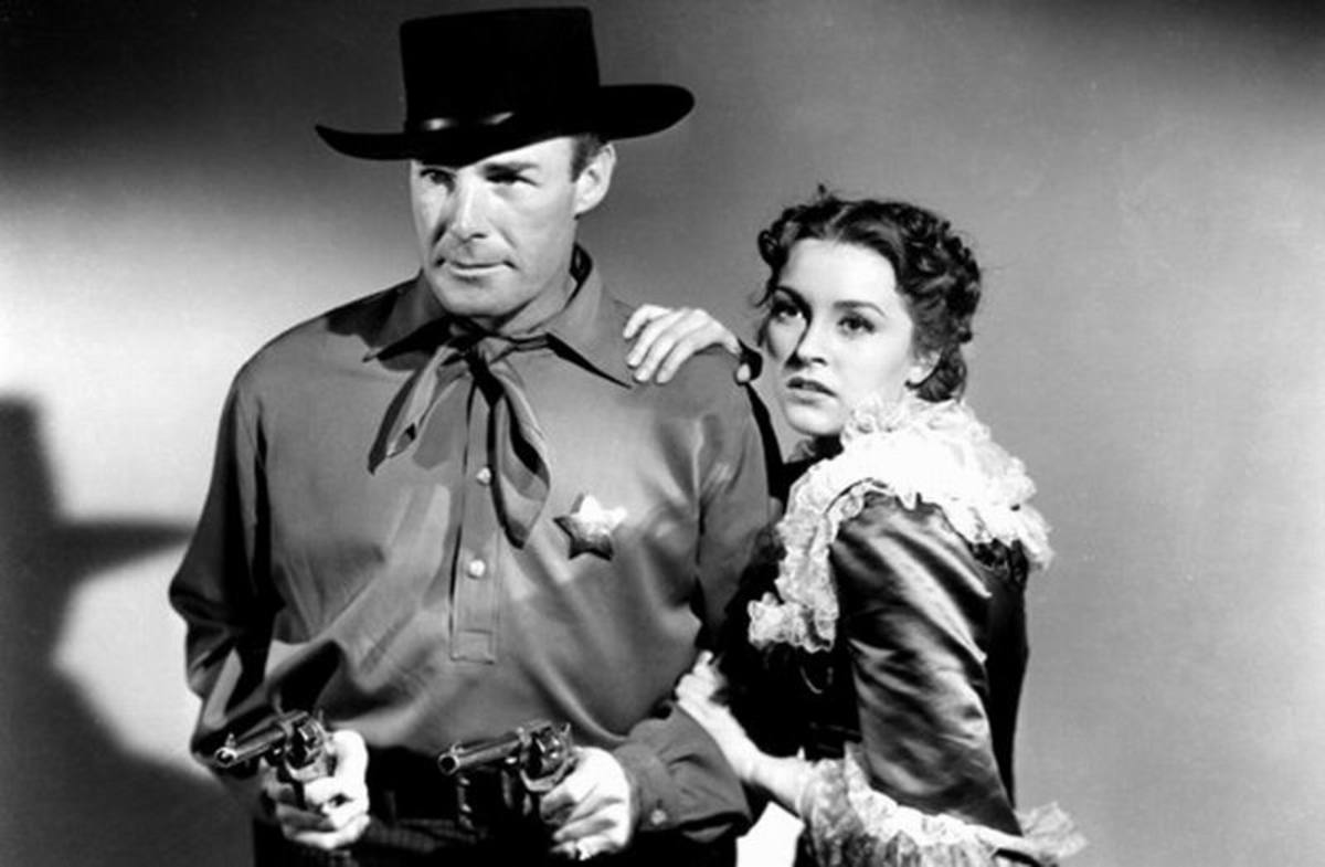 Randolph Scott and Nancy Kelly in Frontier Marshal (1939)