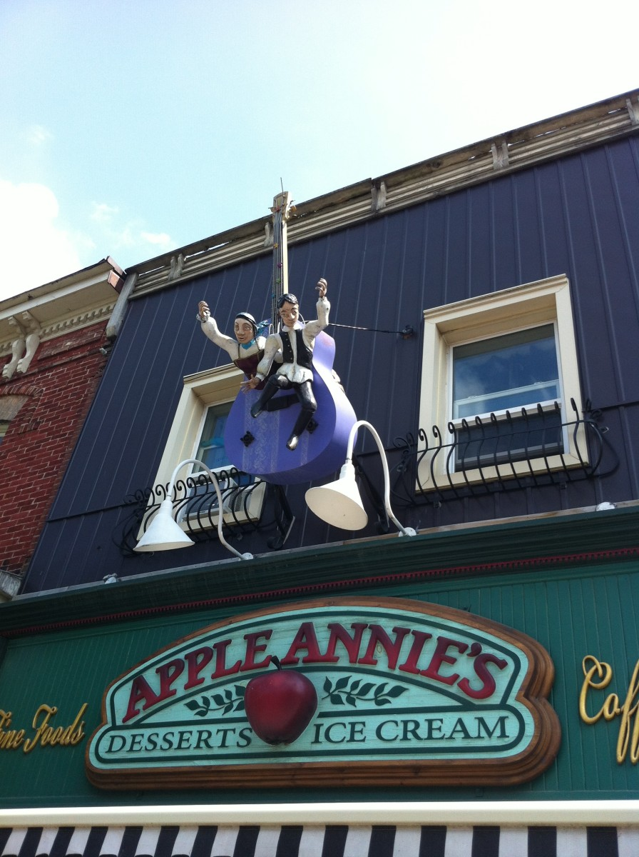 This guitar was originally displayed on  Mississauga St. then later hung above Apple Annie's (A store that has delicious homemade fudge along with other delightful treats)