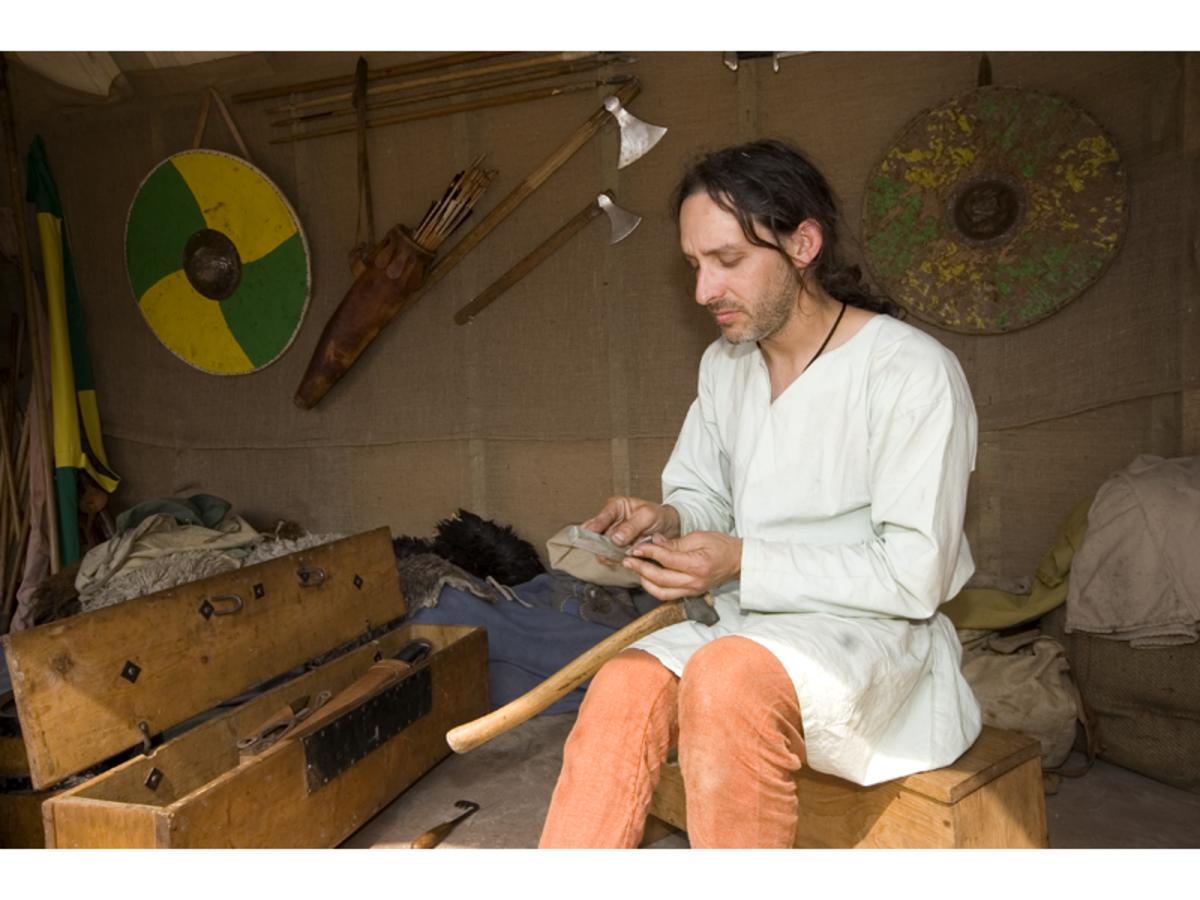 Craftsman repairs tools at the 2006 Viking Festival