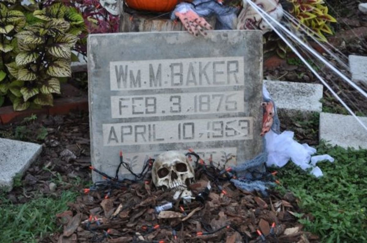Customized gravestones add a spooky feel to the Halloween decorations outside the house