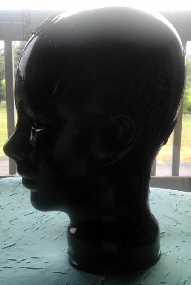 Ceramic head modeling a comb coil headband.