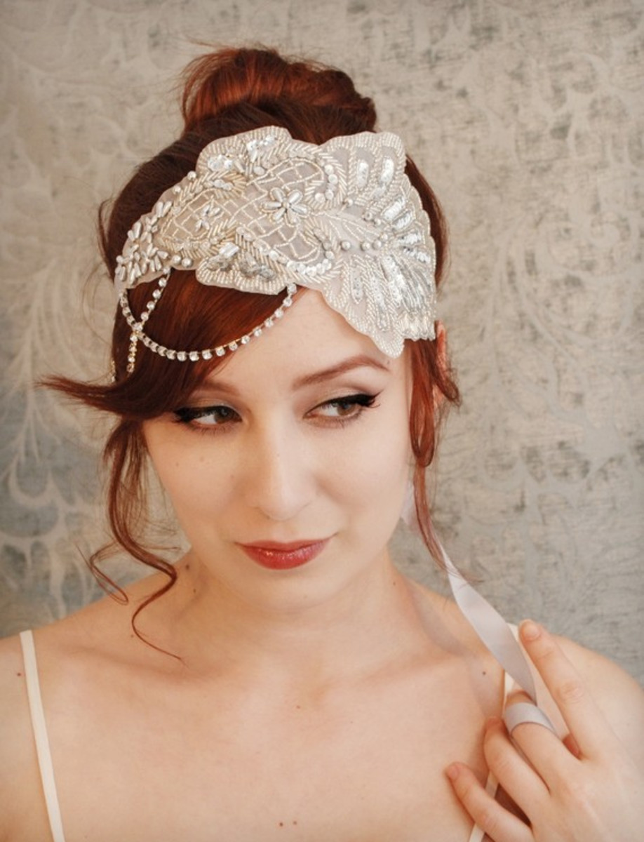 Suitable for a bride, this beaded white headband is demure yet womanly.