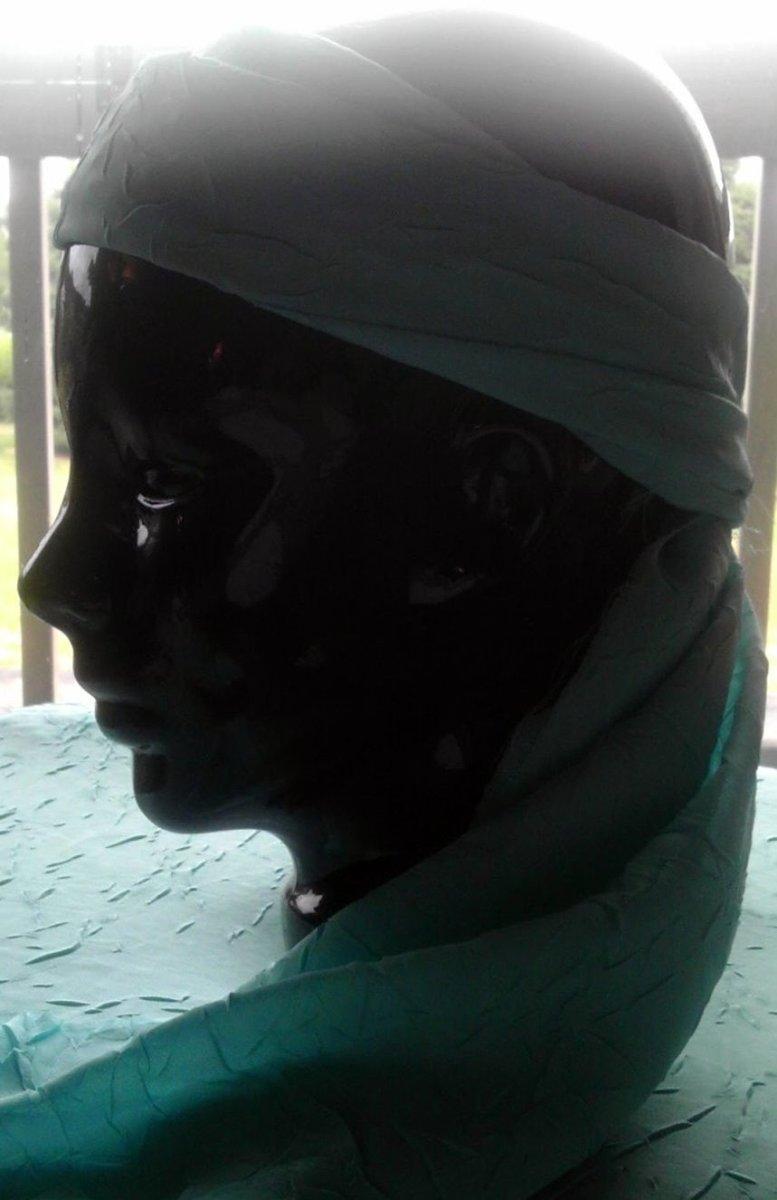 Ceramic head modeling a scarf headband.