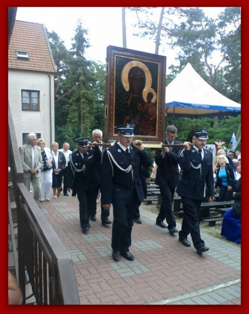 The icon is currently (June 16, 2012) touring Northern Poland in a special van, with police and fire brigade escorts.  Here it is being processed from the open-air Mass at the Capuchin Church in Krynice Morska, on the Baltic. The uniformed men are fi