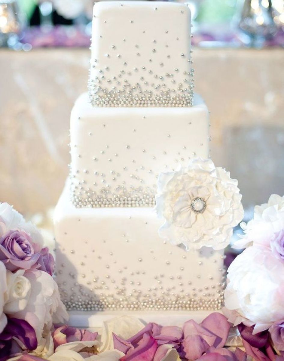 Vintage wedding cake with lace and accents that will wow your guests