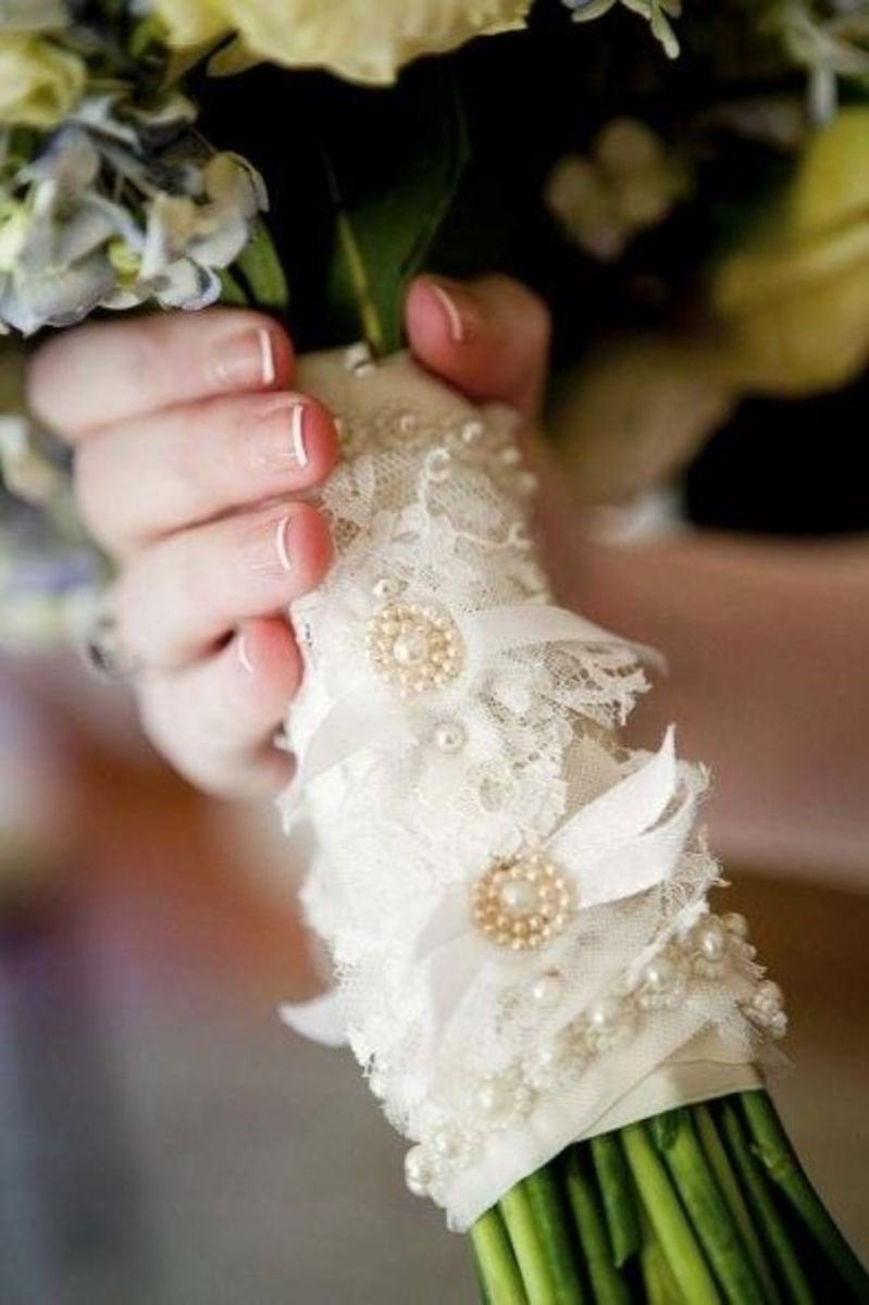 A simple bouquet wrapped with a lace wrap decorated with gems is a graceful touch to your lace wedding