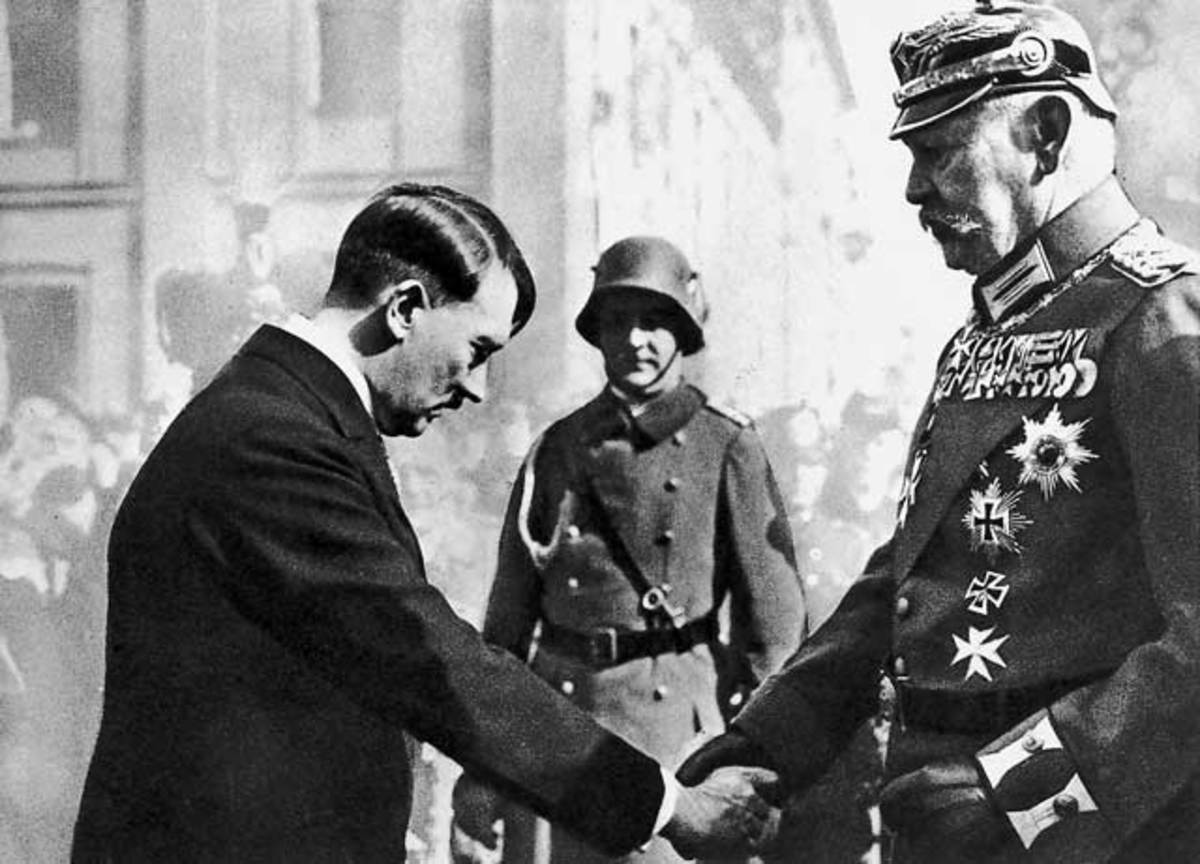 Adolf Hitler bowing in respect to President Paul von Hindenburg.