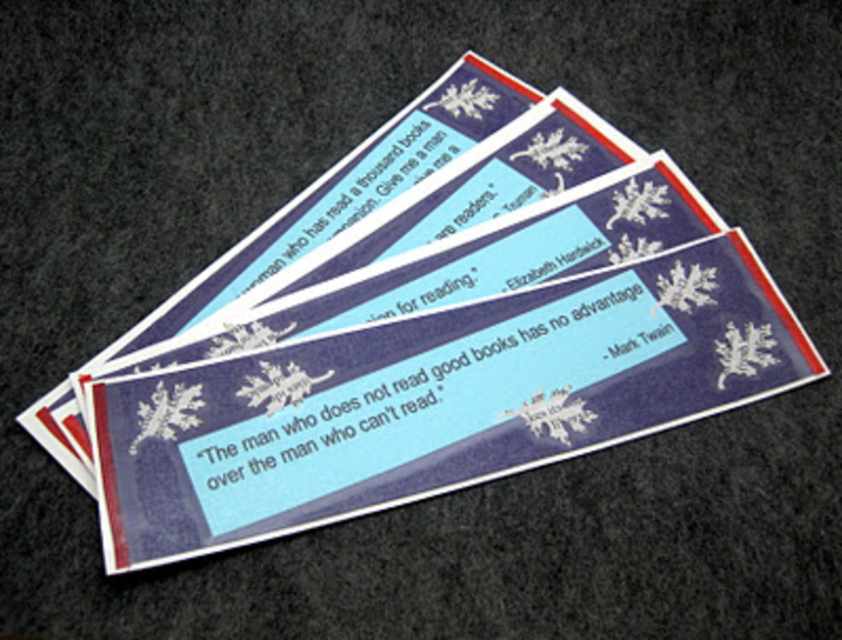I used famous quotes about reading for those bookmarks.  I covered them in contact paper so that they'll have a long life span.