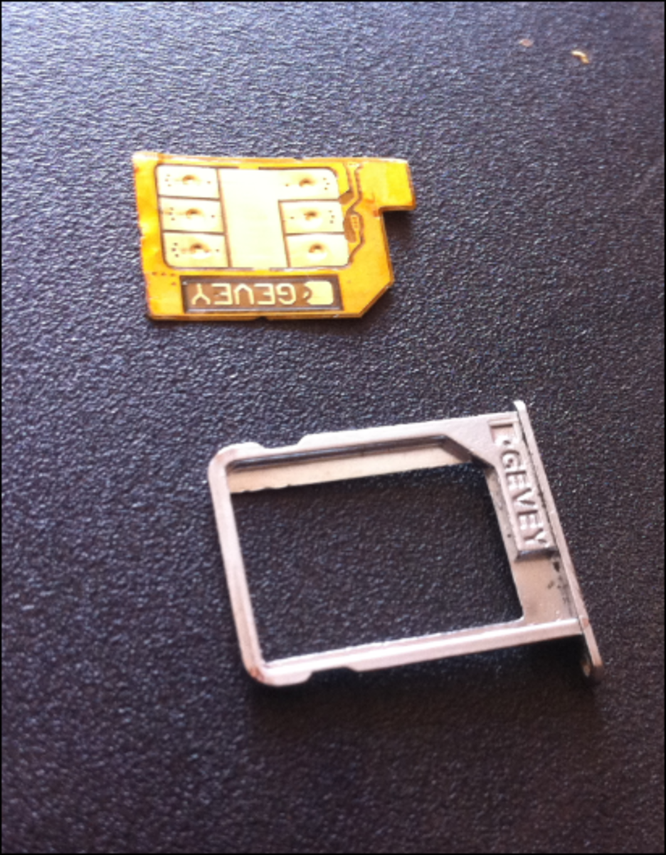 A sample Gevey SIM tray interposer which is placed under the unssurpoted SIM card.