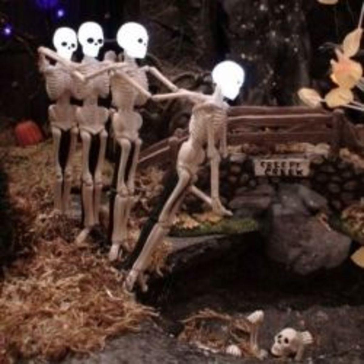 Skeletons in a Halloween village