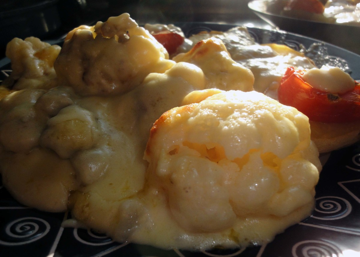 Cauliflower Cheese Recipe Served With Baked Potatoes and Baked Tomatoes